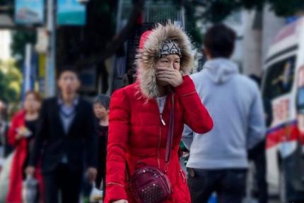 十堰今晨气温降至个位数 市民冬装穿上身